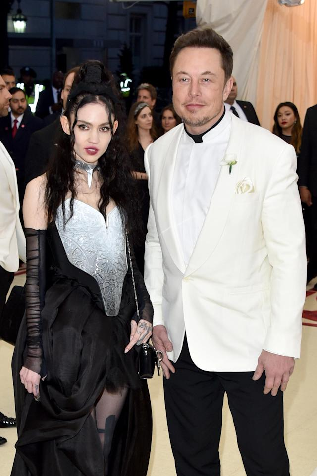 Elon Musk and Grimes at the Heavenly Bodies: Fashion and the Catholic Imagination Costume Institute gala at the Metropolitan Museum of Art on May 7, 2018, in New York City. (Photo: Getty Images)