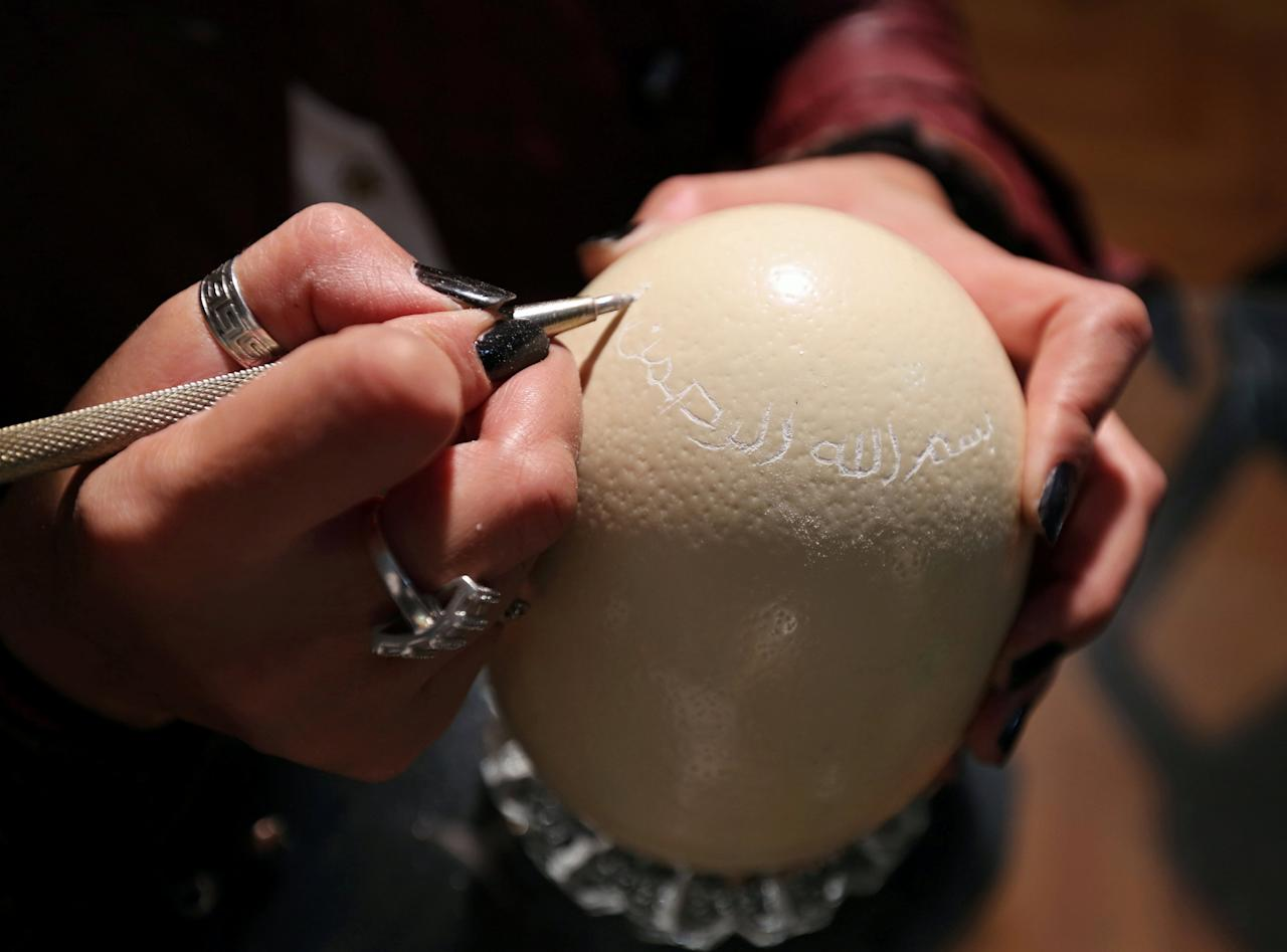 """A businesswoman Maha Shalaby sculpts """"in the name of Allah the most merciful"""" onto an ostrich egg in Cairo, Egypt November 27, 2016. Picture taken November 27,2016. REUTERS/Mohamed Abd El Ghany      TPX IMAGES OF THE DAY"""