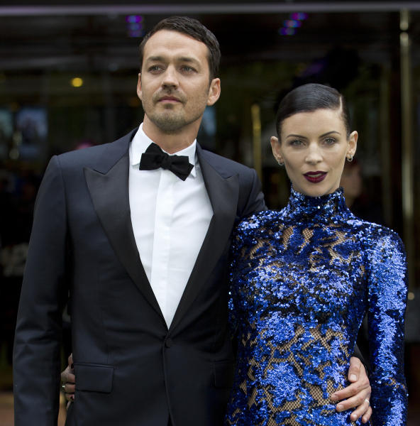 "FILE - In this May 14, 2012 file photo, actress Liberty Ross with director Rupert Sanders pose for the media at the World Premiere of the film, ""Snow White and the Huntsman,"" at a cinema in central London. Ross filed for divorce on Friday, Jan. 28, 2013 in Los Angeles, roughly five months after it was revealed that Sanders had engaged in a brief affair with actress Kristen Stewart. (AP Photo/Alastair Grant, File)"