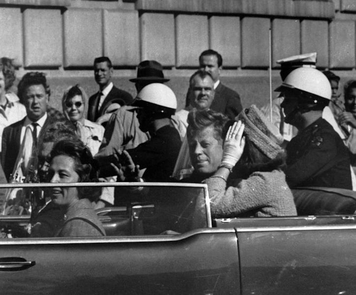 FILE - This Nov. 22, 1963 file photo shows President John F. Kennedy riding in motorcade with first lady Jacqueline Kenndy before he was shot in Dallas, Texas. The Sept. 11, 2001 terrorist attack is by far the most memorable moment shared by television viewers during the past 50 years, a study released on Wednesday, July 11, 2012 concluded. The only thing that came close was President John F. Kennedy's assassination and its aftermath in 1963, but that was only for the people aged 55 and over who experienced the events as they happened instead of replayed as an historical artifact. (AP Photo, file)