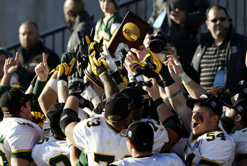 North Dakota State celebrates with the trophy following their 39-13 win in the FCS Championship NCAA college football game against Sam Houston State, Saturday, Jan. 5, 2013, in Frisco, Texas. (AP Photo/Tony Gutierrez)
