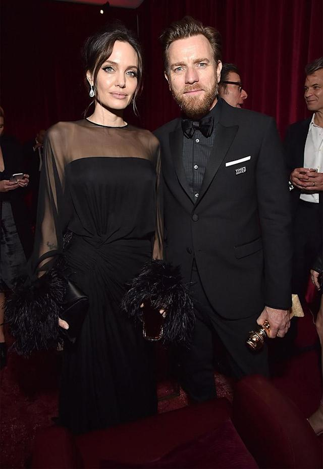 "<p>Angelina Jolie and Ewan McGregor caught up at the Netflix after-party at the Waldorf Astoria Beverly Hills. While the <em>Fargo</em> winner didn't thank his old pal in his Golden Globes acceptance speech, he made sure to shout out to both his <a href=""https://www.yahoo.com/entertainment/ewan-mcgregor-thanks-estranged-wife-032038575.html"" data-ylk=""slk:estranged wife and rumored girlfriend;outcm:mb_qualified_link;_E:mb_qualified_link"" class=""link rapid-noclick-resp newsroom-embed-article"">estranged wife and rumored girlfriend</a>. (Photo: Kevin Mazur/Getty Images for Netflix) </p>"