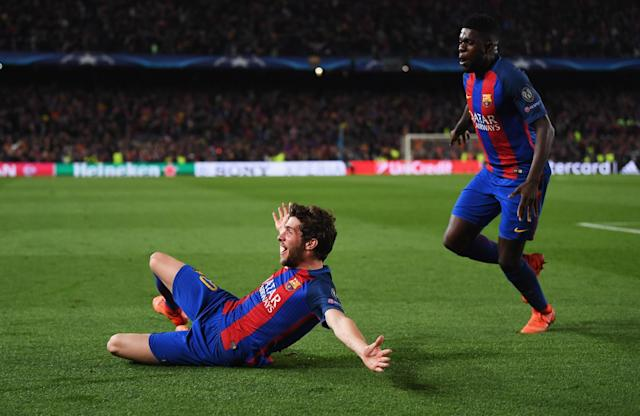 <p>Sergi Roberto of Barcelona (L) celebrates with Samuel Umtiti as he scores their sixth goal during the UEFA Champions League Round of 16 second leg match between FC Barcelona and Paris Saint-Germain at Camp Nou on March 8, 2017 in Barcelona, Spain. (Photo by Laurence Griffiths/Getty Images) </p>