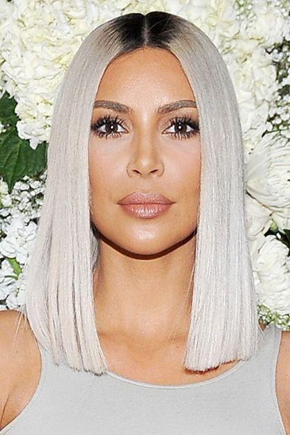 <p>Kim Kardashian infamously transformed her naturally dark brown hair into a bleached blonde bob overnight in time for Paris Fashion Week.</p>