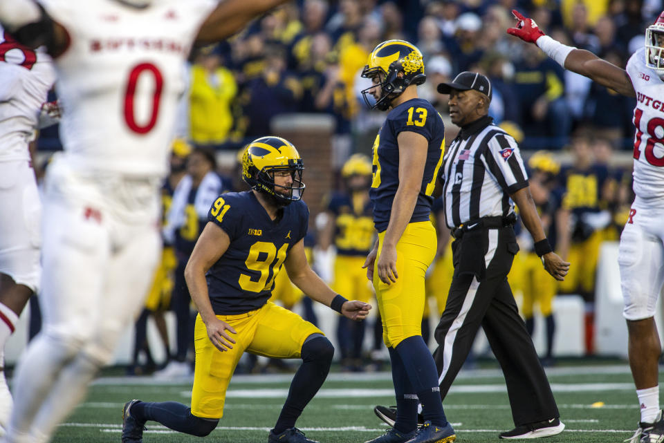 Michigan punter Brad Robbins (91) and kicker Jake Moody (13) reacts to Moody's failed attempt at a 47-yard field goal in the fourth quarter of an NCAA college football game against Rutgers in Ann Arbor, Mich., Saturday, Sept. 25, 2021. Michigan won 20-13. (AP Photo/Tony Ding)