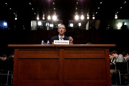 FILE PHOTO: Facebook CEO Mark Zuckerberg testifies before a joint Senate Judiciary and Commerce Committees hearing regarding the company's use and protection of user data, on Capitol Hill in Washington, DC, U.S., April 10, 2018.   REUTERS/Aaron P. Bernstein/File Photo
