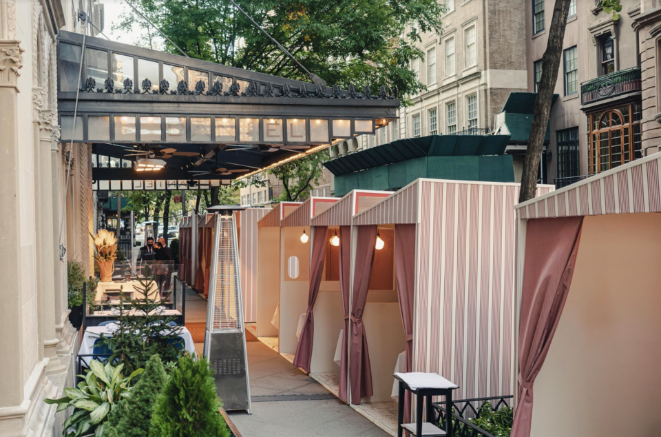 Chef Boulud's restaurants utilize heated, curbside bungalows to shield customers from harsh winter winds while dining outdoors (Credit: Daniel Boulud)
