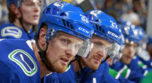 Henrik and Daniel Sedin will have their jerseys retired by the Vancouver Canucks in February. (Photo by Jeff Vinnick/NHLI via Getty Images)