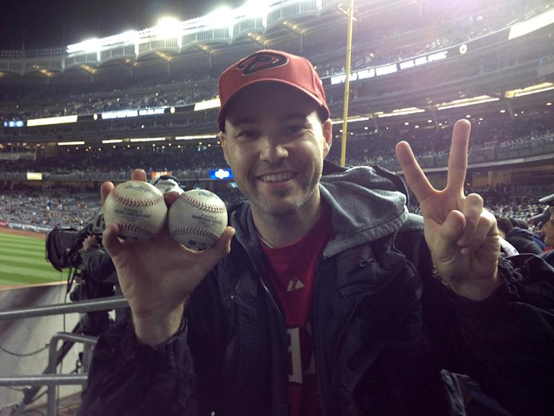 Zack Hample, a 35-year-old New Yorker holds the two balls he caught in the right-field seats Thursday April 18, 2013 during the Yankess Diamondbacks game. Hample, who wrote a how-to book about snagging big league baseballs, said he caught two home runs at a game for the second time after accomplishing the feat at Baltimore's Camden Yards on drives by Seattle's Michael Saunders and the Orioles' Corey Patterson on May 13, 2010. (AP Photo/Jeremy Engdahl-Johnson)