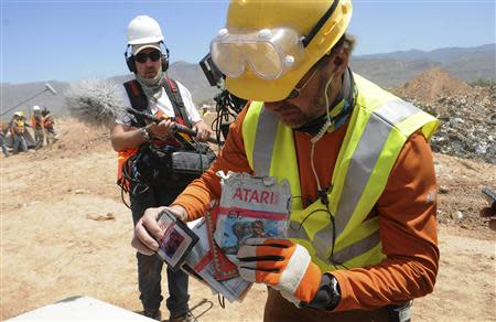 Archaeologist Andrew Reinhard shows off the first E.T. the Extra-Terrestrial cartridges recovered from the old Alamogordo landfill, in Alamogordo