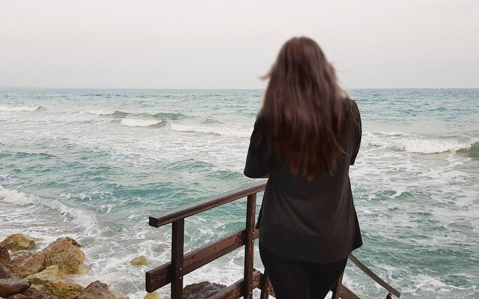 The young British woman gazes out to sea on the coast of Cyprus following her conviction - ITV picture desk