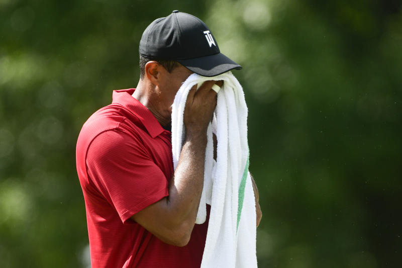 Tiger Woods dries sweat from his face while on the fourth during the final round of the Tour Championship golf tournament Sunday, Sept. 23, 2018, in Atlanta. (AP Photo/John Amis)