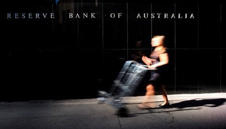 Australia's central bank cuts rates again, says ready to ease more if needed