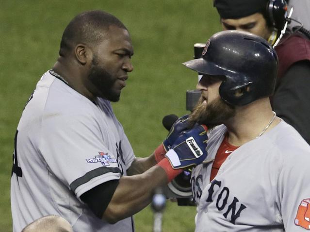 Boston Red Sox's David Ortiz pulls on the beard of Mike Napoli after Napoli hits a home run in the seventh inning during Game 3 of the American League baseball championship series against the Detroit Tigers Tuesday, Oct. 15, 2013, in Detroit. (AP Photo/Carlos Osorio)