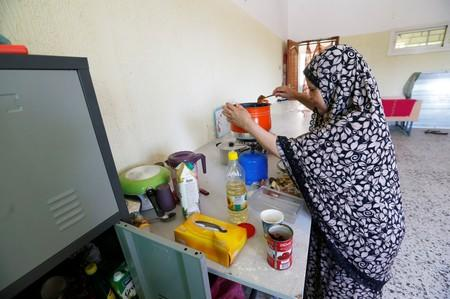Tabra al-Hamali, a Libyan displaced woman, prepares meals in a school used as a shelter at Abu Slim district in Tripoli