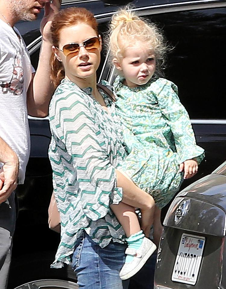Amy Adams carried her own little Goldilocks, 3-year-old daughter Aviana, into school in L.A. Obviously, good hair runs in the family! (5/24/2013)