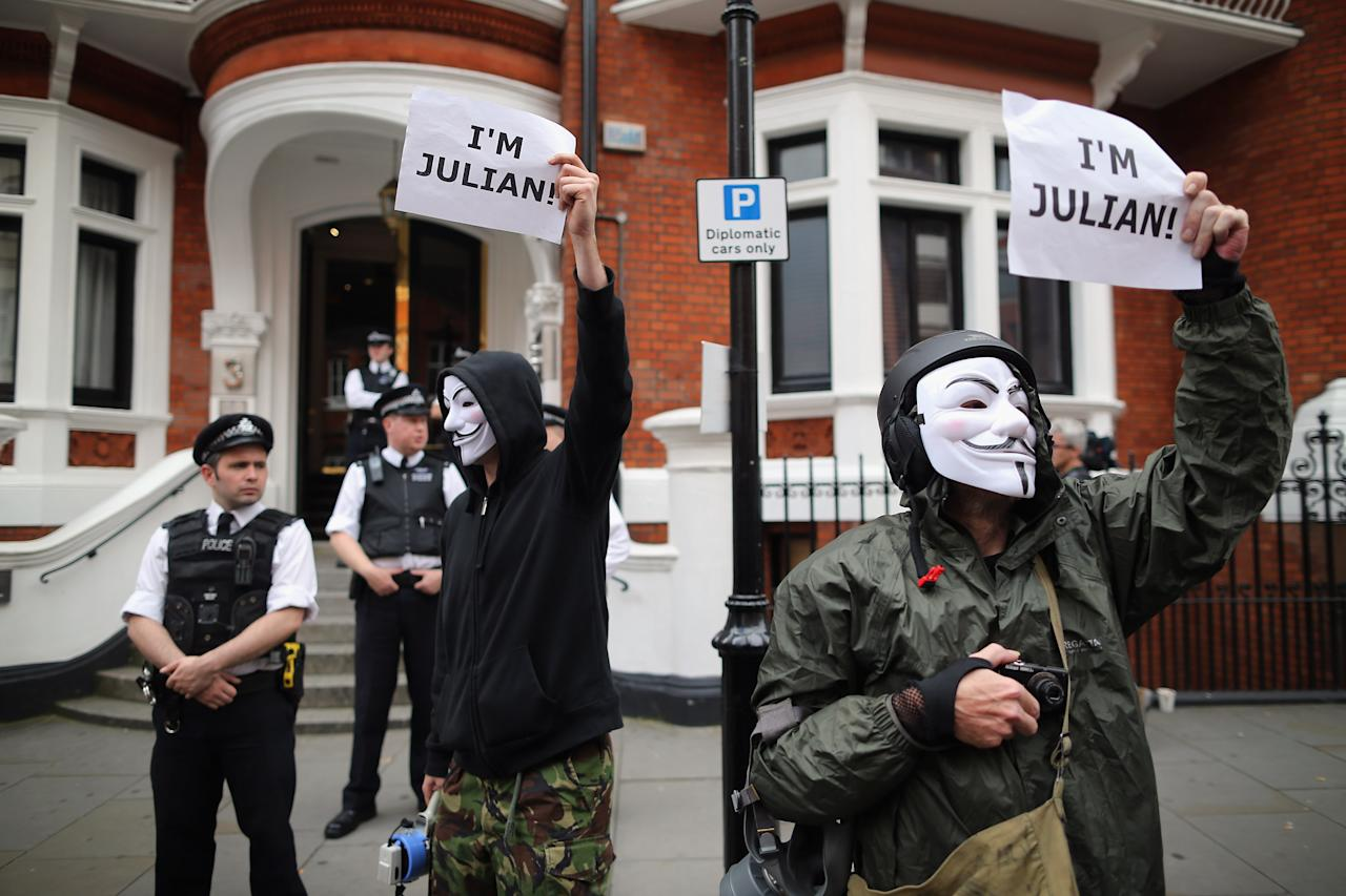 Protesters gather outside the Ecuadorian Embassy, where Julian Assange, founder of Wikileaks is staying on August 16, 2012 in London, England. Mr Assange has been living inside Ecuador's London embassy since June 19, 2012 after requesting political asylum whilst facing extradition to Sweden to face allegations of sexual assault.  (Photo by Dan Kitwood/Getty Images)