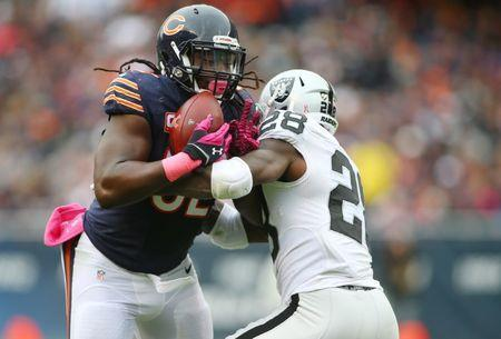 FILE PHOTO: Oct 4, 2015; Chicago, IL, USA; Chicago Bears outside linebacker Pernell McPhee (92) intercepts a pass intended for Oakland Raiders running back Latavius Murray (28) during the second quarter at Soldier Field. Mandatory Credit: Jerry Lai-USA TODAY Sports