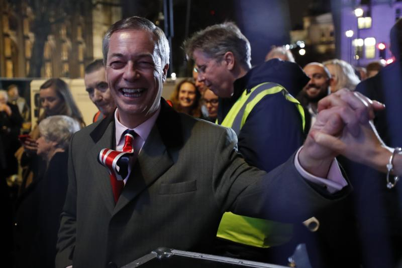Brexit Party leader Nigel Farage shakes hands with his supporters in London during Brexit celebrations. (AP)
