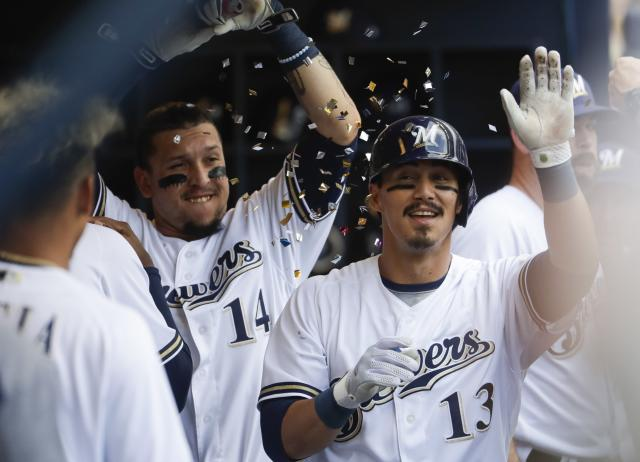 Milwaukee Brewers' Tyler Saladino is congratulated after hitting a home run during the seventh inning of a baseball game against the Arizona Diamondbacks Wednesday, May 23, 2018, in Milwaukee. (AP Photo/Morry Gash)