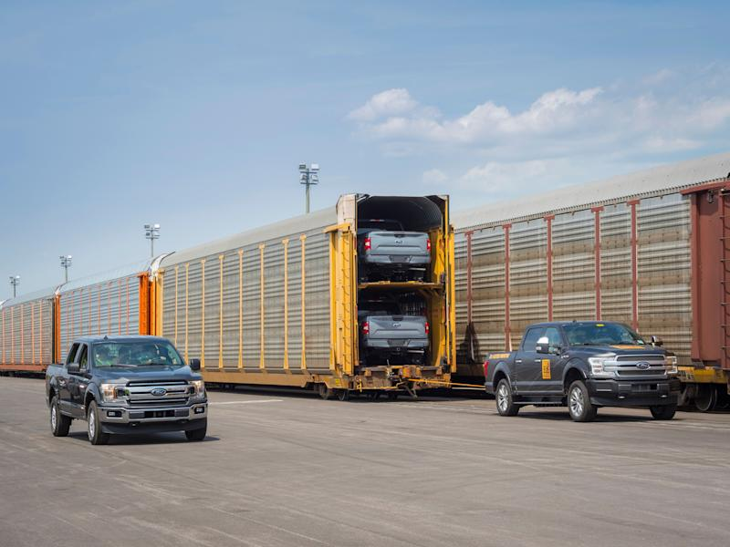 Ford's pick-up tows train full of F-150s.