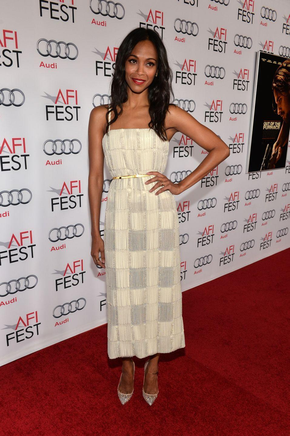 <p>Zoë Saldana wore sparkly pumps to a screening of <em>Out of the Furnace</em> in Hollywood, using a white dress with a metallic belt to pull the look together.</p>