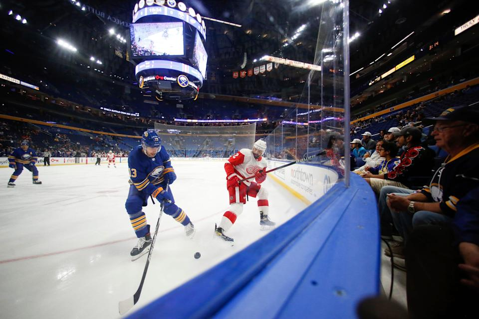 Red Wings defenseman Nick Leddy, right, passes the puck while defended by Sabres defenseman Mark Pysyk (13) during the preseason game in Buffalo, N.Y., Saturday, Oct. 9, 2021.
