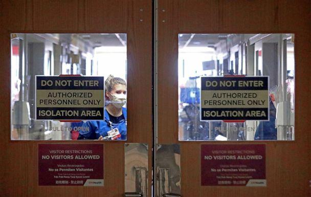 PHOTO: Doors to a COVID-19 treatment unit at UW Health in Madison, Wis. caution hospital personnel and visitors, Nov. 5, 2020. (John Hart/Wisconsin State Journal via AP)