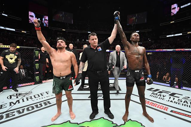 (R-L) Israel Adesanya reacts after defeating Kelvin Gastelum in their interim middleweight title bout during UFC 236 at State Farm Arena on April 13, 2019, in Atlanta. (Josh Hedges/Zuffa LLC via Getty Images)