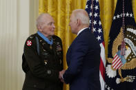 President Joe Biden speaks with retired U.S. Army Col. Ralph Puckett after he was presented the Medal of Honor, in the East Room of the White House, Friday, May 21, 2021, in Washington. (AP Photo/Alex Brandon)