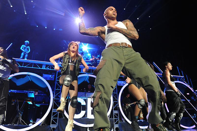 Chris Brown performs live as part of the F.A.M.E Tour at The Staples Center, Thursday, Oct. 20, 2011, in Los Angeles. The F.A.M.E. Tour began Sept. 12, in Toronto, and will end Oct. 30 in Hartford, Connecticut. (AP Photo/Katy Winn)