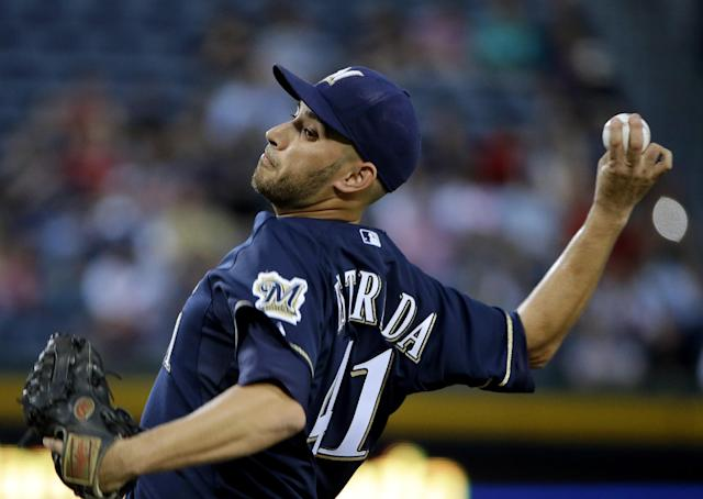 Milwaukee Brewers starting pitcher Marco Estrada throws in the first inning of a baseball game against the Atlanta Braves, Monday, Sept. 23, 2013, in Atlanta. (AP Photo/David Goldman)