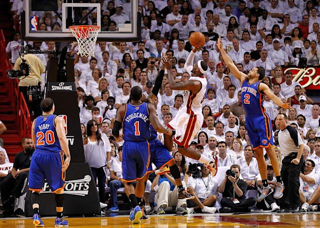 MIAMI, FL - APRIL 30: LeBron James #6 of the Miami Heat shoots over Carmelo Anthony #7 of the New York Knicks during Game Two of the Eastern Conference Quarterfinals in the 2012 NBA Playoffs at American Airlines Arena on April 30, 2012 in Miami, Florida. NOTE TO USER: User expressly acknowledges and agrees that, by downloading and/or using this Photograph, User is consenting to the terms and conditions of the Getty Images License Agreement. (Photo by Mike Ehrmann/Getty Images)