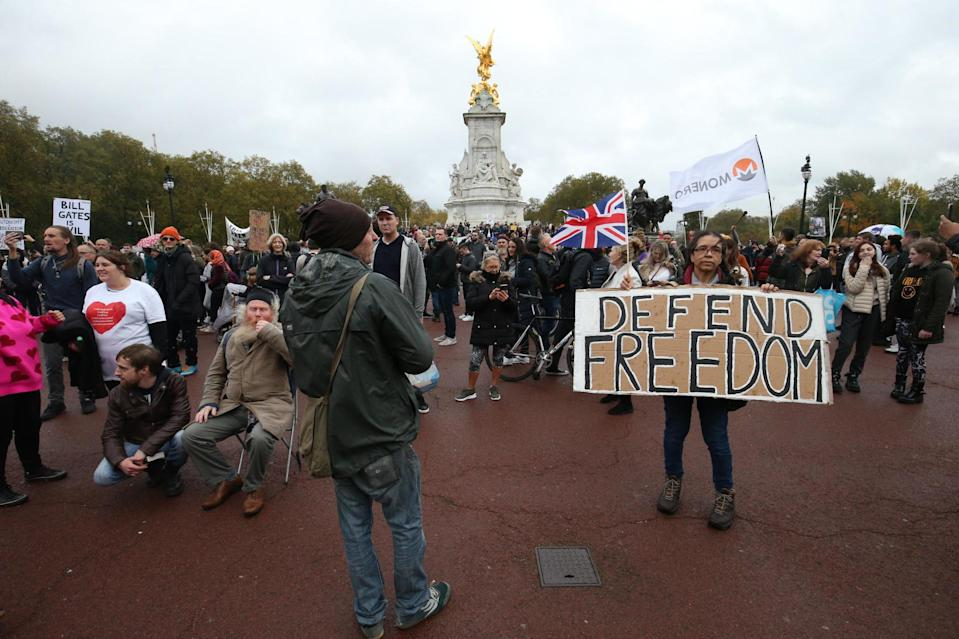 Demonstrators gather in front of the Queen Victoria Memorial at the gates of Buckingham Palace (PA)