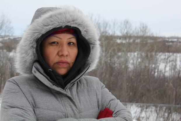 Cecile Moosomin wants to see a referendum held within the Mosquito Grizzly Bear's Head Lean Man First Nation to determine whether or not leadership will go ahead with a land settlement that would see the First Nation receive $127 million or, instead, pursue the land itself.  (Morgan Modjeski/CBC - image credit)