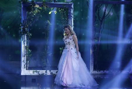 "Contestant Jennifer Grout walks on the stage during the Season 3 finale of ""Arabs Got Talent"" in Zouk Mosbeh area, north of Beirut December 7, 2013. REUTERS/Mohammed Azakir"