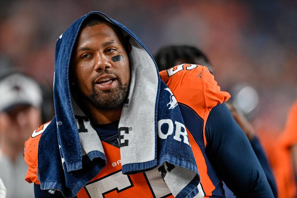 DENVER, CO - AUGUST 28:  Bradley Chubb #55 of the Denver Broncos looks on in the bench area during an NFL preseason game against the Los Angeles Rams at Empower Field at Mile High on August 28, 2021 in Denver, Colorado. (Photo by Dustin Bradford/Getty Images)