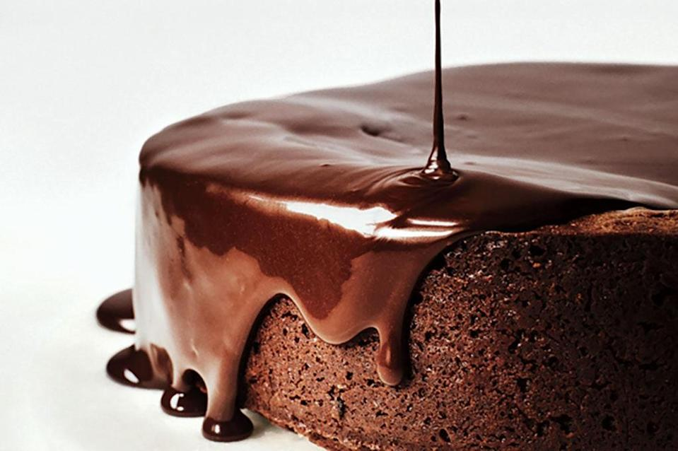 """The plummy-berry notes of red wine are highlighted when mixed with chocolate and butter into a glaze that drips over the edges of this decadent dark chocolate cake. <a href=""""https://www.epicurious.com/recipes/food/views/darkest-chocolate-cake-with-red-wine-glaze-51214740?mbid=synd_yahoo_rss"""" rel=""""nofollow noopener"""" target=""""_blank"""" data-ylk=""""slk:See recipe."""" class=""""link rapid-noclick-resp"""">See recipe.</a>"""