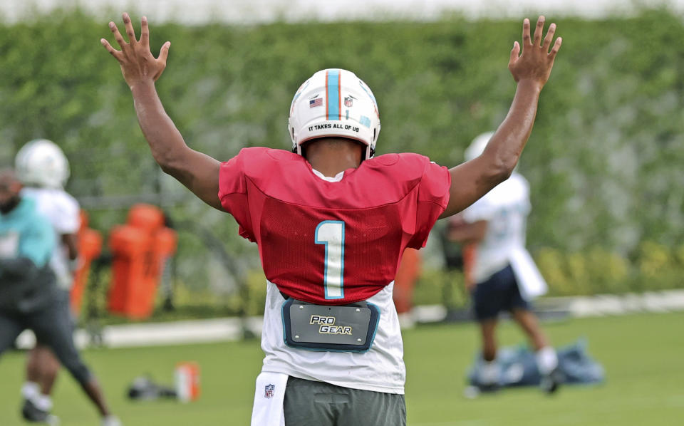 Miami Dolphins quarterback Tua Tagovailoa (1) reacts after a play during practice at Baptist Health Training Complex in Hard Rock Stadium on Wednesday, October 13, 2021 in Miami Gardens, Florida, in preparation for their game against the Jacksonville Jaguars at Tottenham Hotspur Stadium in London on Sunday, October 17.(David Santiago/Miami Herald via AP)