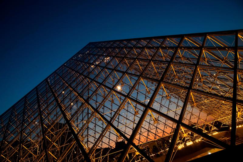 FILE - MAY 16, 2019: It was reported that legendary Chinese American architect I.M. Pei, whose designs include the glass pyramid at Louvre Museum in Paris, the Museum of Islamic Art in Doha, the National Gallery of Art's East Building, and the Jacob K. Javits Convention Center, has died at the age of 102. A picture taken on March 21, 2019, shows the sunset behind the Louvre Pyramid in Paris. - Chinese born US architect Ieoh Ming Pei's pyramid celebrates its 30th anniversary this month. (Photo by KENZO TRIBOUILLARD / AFP) / RESTRICTED TO EDITORIAL USE - MANDATORY MENTION OF THE ARTIST UPON PUBLICATION - TO ILLUSTRATE THE EVENT AS SPECIFIED IN THE CAPTION (Photo credit should read KENZO TRIBOUILLARD/AFP/Getty Images) ORIG FILE ID: 1131907832.jpg