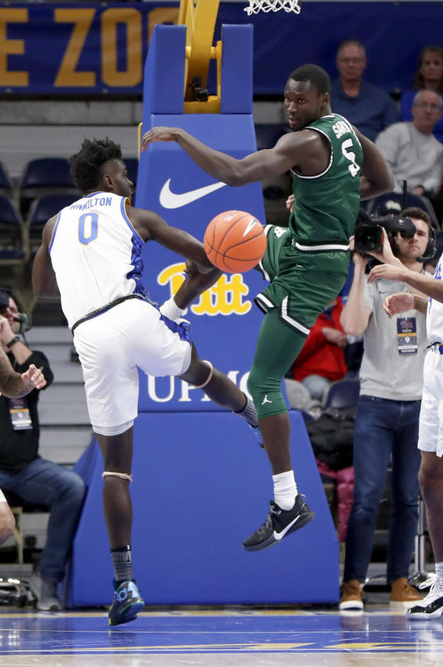 The ball gets away from Pittsburgh's Eric Hamilton (0) and Binghamton's Pierre Sarr (5) as they pursue a rebound during the first half of an NCAA college basketball game Friday, Dec. 20, 2019, in Pittsburgh. (AP Photo/Keith Srakocic)