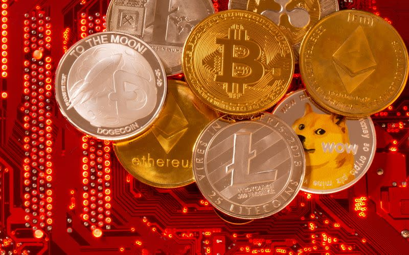 FILE PHOTO: Representations of cryptocurrencies Bitcoin, Ethereum, DogeCoin, Ripple, Litecoin are placed on PC motherboard in this illustration taken