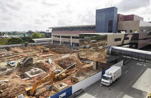 This Feb. 2014 photo released by Portal da Copa shows construction at the Afonso Pena International Airport in Curitiba, Brazil. Most analysts say they don't expect total chaos when the Cup begins on June 12. But they say fans should brace for unfinished construction work, long check-in lines, last-minute gate changes and flight delays, all already too common in the country's airports. (AP Photo/Portal da Copa, Alexandre Carnieri)