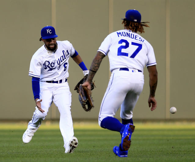 Kansas City Royals center fielder Billy Hamilton (6) and shortstop Adalberto Mondesi (27) run to field a ball hit by Chicago White Sox's Jon Jay during the fourth inning of a baseball game at Kauffman Stadium in Kansas City, Mo., Monday, July 15, 2019. (AP Photo/Orlin Wagner)