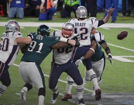 Feb 4, 2018; Minneapolis, MN, USA; Philadelphia Eagles defensive end Brandon Graham (55) sacks New England Patriots quarterback Tom Brady (12) and forces a fumble in the fourth quarter in Super Bowl LII at U.S. Bank Stadium. Mandatory Credit: Kirby Lee-USA TODAY Sports
