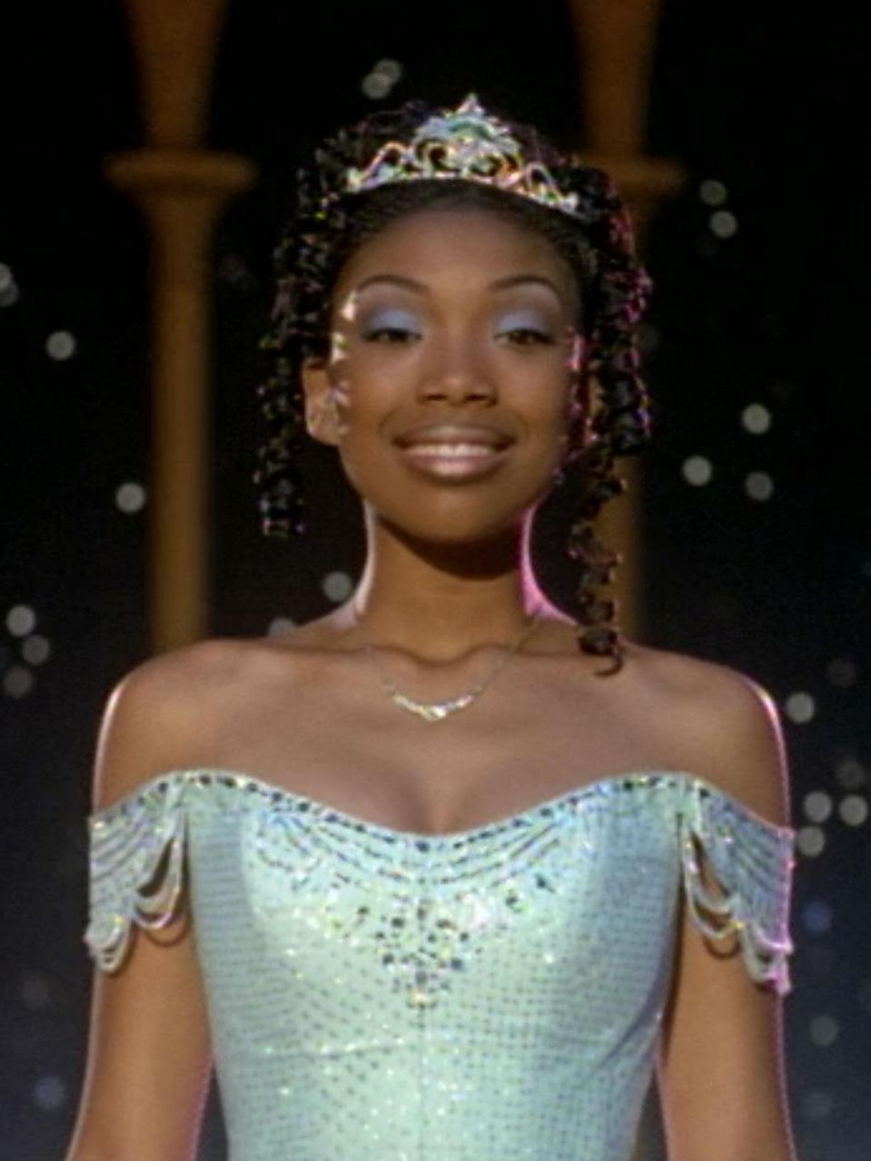"""<p>Aside from the UPN series, Brandy totally changed the game when she starred in <em>Cinderella. </em>With her performance, finally, we were able to see the classic fairytale in a whole new light. This version (which also starred the incredible Whitney Houston) proved that Black girls, with our brown skin, wide noses, and braids — features we were taught were """"wrong"""" or """"bad"""" — could be princesses, too. </p>"""
