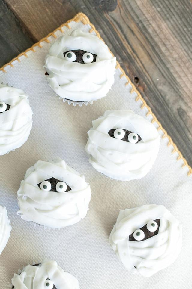 "<p>No toilet paper here. Instead use white frosting and sugary eyes to give these chocolate cookies a mummified effect. </p><p><em><a rel=""nofollow"" href=""https://sugarandcharm.com/2012/10/chocolate-and-vanilla-mummy-cupcakes.html?section-1"">Get the recipe at Sugar and Charm »</a></em></p><p><strong>What you'll need:</strong> icing bags with tips ($10, <a rel=""nofollow"" href=""https://www.amazon.com/Cake-Boss-Decorating-Tools-Icing/dp/B00K58G358/ref=sr_1_4?"">amazon.com</a>), cupcake pan ($7, <a rel=""nofollow"" href=""https://www.amazon.com/Wilton-Recipe-Nonstick-12-Cup-Regular/dp/B003W0UMPI/ref=sr_1_5?"">amazon.com</a>)</p>"