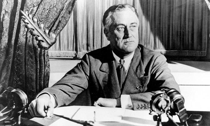 President Franklin D Roosevelt delivers his first radio 'fireside chat' in 1933. Biden sees parallels today with the situation facing Roosevelt, whose New Deal was instrumental in pulling the US out of the Great Depression.