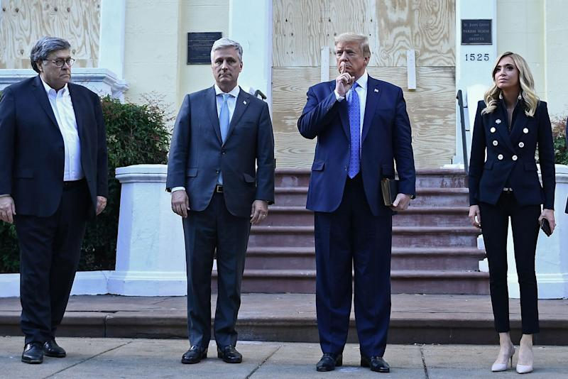 President Donald Trump holds a Bible as he stands with Attorney General William Barr, left, White House chief of staff Mark Meadows and White House press secretary Kayleigh McEnany at St. John's Episcopal Church across from Lafayette Park in Washington.  (Photo: BRENDAN SMIALOWSKI/AFP via Getty Images)