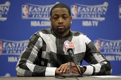 Miami Heat guard Dwyane Wade talks with the media after Game 1 of the Eastern Conference finals NBA basketball playoff series against the Indiana Pacers Sunday, May 18, 2014, in Indianapolis. The Pacers won 107-96. (AP Photo/AJ Mast)